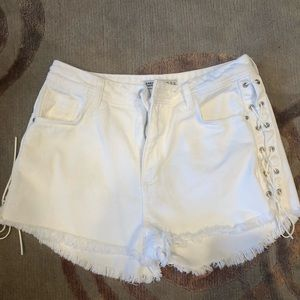 White denim shorts with laces